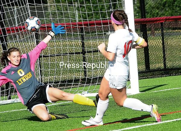 Plattsburgh's Madeline Saccocio (10) sends a shot past Lyndon's goalie Johanna Sargent for a goal Sunday during women's soccer action at the SUNY Plattsburgh field house. <br /> ROB FOUNTAIN/STAFF PHOTO 9-12-2016