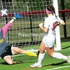 Plattsburgh's Madeline Saccocio (10) sends a shot past Lyndon's goalie Johanna Sargent for a goal Sunday during women's soccer action at the SUNY Plattsburgh field house. <br /> ROB FOUNTAIN/STAFF PHOTO 9-12-2016