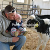 JOANNE KENNEDY/P-R PHOTO<br /> Eight-month-old Islah Hughes, held by her father, Jon, meets a calf for the first time at the Remillard Farm in Peru. The baby's dad is an employee there.