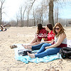 KAYLA BREEN/STAFF PHOTO <br /> Abigail Hunt (left), Lauren Sargent (middle) and Chloe Murasso take a break from classes to soak up the sun at Plattsburgh City Beach. College students are in their final weeks of classes for the spring semester.