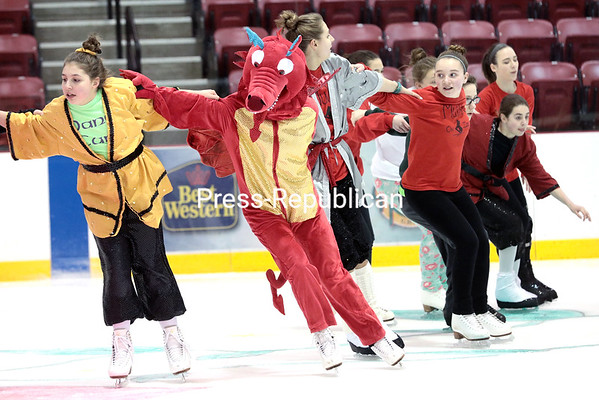 GABE DICKENS/ P-R PHOTOS The cast of Mulan on Ice practice a routine during rehearsal.