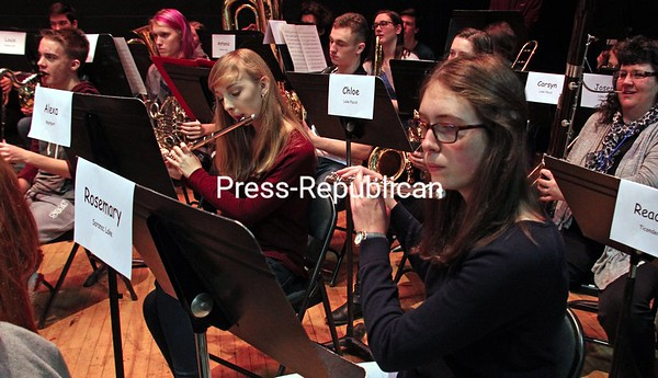 """ALVIN REINER/ P-R PHOTO The 2017 All County Concert Band practices """"Cajun Folk Songs"""" before the Essex County School Music Association's High School All-County Festival Concert at Elizabethtown-Lewis Central School. Along with the Concert Band, the event featured a jazz band and mixed chorus comprising students from 11 schools in Essex County."""