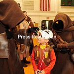 JACK LaDUKE/P-R PHOTO Jacob Manely, 7, of Fort Covington faces off with two Jawas from the Planet Tatooine, characters from ?Star Wars.? A big crowd showed up for the second-annual Comic ...