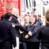KAYLA BREEN/STAFF PHOTO<br /> Wendy Plympton and her daughter, Amanda, greet Beekmantown Fire Department Assistant Chief Mark LaFountain during a firetruck salute in Wendy's honor held Monday in Plattsburgh. Wendy is retiring as secretary of Clinton County Emergency Services after almost 36 years. More than 35 vehicles sent by area emergency and law-enforcement departments formed the farewell line along Arizona Avenue. Walking down the line, Wendy shook hands with and thanked each representative.