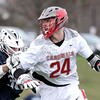 GABE DICKENS/ P-R PHOTO<br /> Plattsburgh State's John Nessim attempts to shrug off a Geneseo defender as he carries the ball during Saturday's SUNYAC lacrosse game at the Field House Athletic Complex.