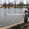 KAYLA BREEN/STAFF PHOTO<br /> Melissa LaMarche and her grandson, Justin, fish along the mouth of the Saranac River at Champlain Park in Plattsburgh. It was Justin's first time fishing.
