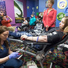 GABE DICKENS/ P-R PHOTO<br /> Phlebotomist II Erica Dupraw draws blood samples from Bianca Deno of Beekmantown while Deno donates blood for the first time. Deno was accompanied by her friend, Charlena Scroggins of Plattsburgh, during a North Country Regional Blood Center blood drive Thursday evening at Cumberland 12 Cinemas in Plattsburgh. Despite her dislike of needles, Deno joined her mother, Heather, to donate blood as a way of giving back to the community, since her grandfather, Mike Gagner, needs a blood transfusion every three weeks to manage his myelodysplastic syndrome, which is a type of blood cancer. A blood drive will take place tomorrow at the Malone Callfiremen Station from 3 p.m. to 7 p.m. and Wednesday at the Adirondack Medical Center in Saranac Lake from 12 p.m. to 5 p.m. For a complete listing of blood drives throughout the North Country into June, visit cvph.org/events. While all types of blood are needed, type AB is in especially high demand.