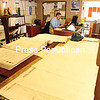JACK LaDUKE/P-R PHOTO<br /> Project Engineer Mark Armstrong works at a table covered with blueprints of the Hotel Saranac at the Saranac Lake project office.