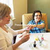 """ROBIN CAUDELL/STAFF PHOTO<br /> <br /> """"Look Good, Feel Better"""" provides free manicures to Meadowbrook Healthcare residents. Darcy Moore, a professional cosmetologist at Ultrawave, spends her days off providing the service."""