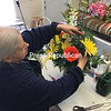 ROBIN CAUDELL/STAFF PHOTO Apple Blossom Florist designer Polly Perky works on an Easter arrangement at Rulfs Orchard.