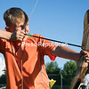 Luke LaForest of Cadyville notches an arrow on a recurve bow and takes aim at a target during a youth archery camp hosted by the Town of Plattsburgh Parks and Recreation at East Morrisonville Park. Hosted by instructor Chelsea Baxter, the archery camp will be traveling to Salmon River Park the week of Aug. 7, with sessions running Monday through Friday from 6 to 7 p.m.. The week of Aug. 14, the Fitness at the Parks event will be at Rouses Point Civic Center, with one class from 6 to 7 p.m. and another from 7 to 8 p.m. weekdays. Parents can sign of their children online at each town's recreation department website.<br /> GABE DICKENS/ P-R PHOTO