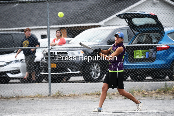 E.T. Harris/Frank's Auto's Tracy Randall connects on a pitch during a Women's FUN League B Division championship game at American Legion Post 1619 in Morrisonville. E.T. Harris/Frank's Auto defeated G& G 10-7.<br /> KAYLA BREEN/ STAFF PHOTO