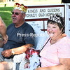 Gary and Linda Moore of Chazy smile as family and friends get up to wish the happy couple congratulations after they were crowned king and queen of the 50th-annual Chazy Old Home Day.<br /> KAYLA BREEN/ STAFF PHOTO