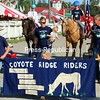 """The Coyote Ridge Riders of Port Henry march in the Essex County Fair's parade at the official opening ceremonies on Wednesday. For the 169th edition of the fair, Jim Westover cut the opening day ribbon and was honored for his many services to the community, including that of Fair Board of Directors member and Westport Volunteer Fire Department chief. One tradition of the fair, the cow-milking contest that normally pits local politicians against one another, was an actual bust, as the artificial cow's udder for the competition burst. But great weather thrilled fair officials and participants alike. """"My heart is for the small fairs,"""" said Essex County Cornell Cooperative Extension Director Rick LeVitre. """"It seems to be a good day, and I am excited to see all the 4-H kids."""" The fair continues through Sunday. See a schedule of fair events on Page A3.<br /> ALVIN REINER/ P-R PHOTO"""