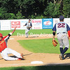Plattsburgh RedBirds left fielder Christian Nazario-Cruz slides into third base during a matchup against the Puerto Rico Islanders Tuesday. The game was suspended due to darkness after the tenth inning with the game tied, 4-4.<br /> KAYLA BREEN/ STAFF PHOTO