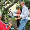 Former Gov. George Pataki stops to greet Ruth Couchey during Downtown Essex Day. Pataki owns a farm in Essex and is seen frequently in the community.<br /> ALVIN REINER/ P-R PHOTO