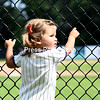 In her striped baseball outfit, 2-year-old baseball fan Maggie Pulsifer waits along the fence Sunday for the Plattsburgh RedBirds to come out of the dugout during their doubleheader against the Puerto Rico Islanders at Chip Cummings Field in Plattsburgh.<br /> STAFF PHOTO/ KAYLA BREEN