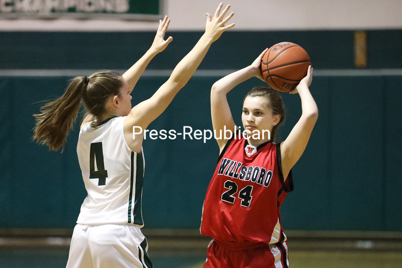 Willsboro's Malina Lawrence (24) looks to pass as Chazy's Natalie Pombrio (4) defends during a Mountain and Valley Athletic Conference girls basketball game Thursday in Chazy.<br /> KAYLA BREEN/ STAFF PHOTO