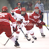 Plattsburgh State's Matt Quilty (14) carries the puck through the neutral zone as Cortland's Logan Blaser (3) and Conor Tierney (28) defend during a SUNYAC men's hockey game Friday at Stafford Ice Arena.<br /> KAYLA BREEN/ STAFF PHOTO