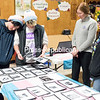 Andy Collins rests his head on the shoulder of Avon Monette as she, Jennifer Tallon and Mandie Rabideau look through cards that memorialize the deaths of transgender people in 2015 and 2016 during the recent Transgender Day of Remembrance, hosted by the Adirondack North Country Gender Alliance at United Methodist Church in Plattsburgh. Monette created the cards when she was vice president of Clinton Community College's Equality Alliance and a student there last year. The international event, founded in 1999 to memorialize the 1998 murder of Rita Hester in Allston, Mass., mourns the lives that were lost and raises awareness for the hate crimes against transgender individuals, which often go unsolved.<br /> GABE DICKENS/ P-R PHOTO