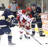 Plattsburgh State's Mackenzie Millen (11) battles for the puck against Trinity's Karinna Cave-Hawkins (7) and Julia Lee (2) during a non-league women's hockey game Saturday at Stafford Ice Arena.<br /> KAYLA BREEN/ STAFF PHOTO