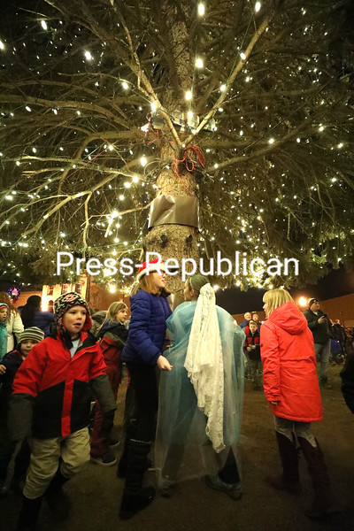 Screaming with excitement, kids run around the trunk of the newly illuminated Christmas tree to get a closer look at the bright lights.<br /> KAYLA BREEN/ STAFF PHOTO