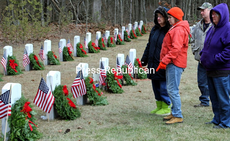 """After placing wreaths on grave sites at the Essex County Veterans Cemetery near Wadhams, these folks are among many of those participating in the Wreaths Across America program pausing to say thanks and share their thoughts. A total of 60 wreaths were placed this holiday season, with Newman Tryon of the American Legion giving a brief history of Wreaths Across America and the Rev. David Sullivan of Good Shepherd Episcopal Church delivering an opening prayer, with more than three dozen veterans and family members taking part. To close the formalities, Kim Matthews performed """"Amazing Grace"""" and Terry Lamb played taps.<br /> ALVIN REINER/ P-R PHOTO"""