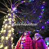 Seven-year-old Grace Duley, Ava Whitmen, 7, and Gabriel Duley, 4, stare up at the colorful Christmas lights adorning a 55-foot-tall white spruce tree during the recent Elfs Winery Christmas Tree Lighting event. Town of Plattsburgh Supervisor Michael Cashman did the honor of throwing the switch to illuminate the 63-year-old tree.<br /> KAYLA BREEN/ STAFF PHOTO