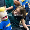 Seton Academy fifth-grader Taylor Dubrey plays with a puppet while posing for a photo with Karen Reynolds and Kathleen Toner's fifth-grade classes following an anti-bullying workshop.<br /> GABE DICKENS/ P-R PHOTO