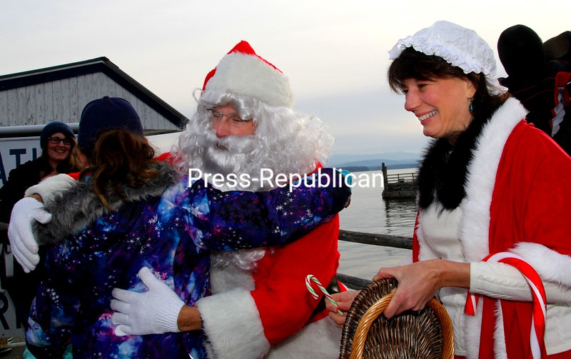 Apparently due to a lack of snow, Santa and Mrs. Claus utilized other conveyances instead of their sleigh to visit Essex via Lake Champlain Ferry and an Essex Volunteer Fire Department truck. Hugs and candy canes were dispensed by the jolly duo on the ferry dock. Among the other activities for Christmas in Essex were a tree lighting, carol sing-a-long, Pleasant Valley Chorale concert, pancake breakfast at the Essex Volunteer Fire Department's firehouse, scavenger hunt, vendors and activities for all ages.<br /> ALVIN REINER/ P-R PHOTO