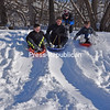 JOANNE KENNEDY/ P-R PHOTO<br /> Regan Baker gives his friend Jack Billington a push as they enjoy sledding with Michael Tabernia (left) and Sam Betrus at Little Ausable Park in Peru. The boys were taking advantage of the fresh snow from the last two days.