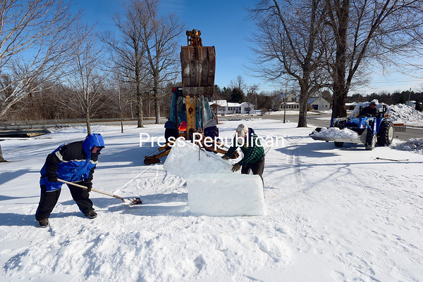 ROB FOUNTAIN/ STAFF PHOTO <br /> Tuesday, volunteers begin to build an ice castle for the upcoming American Legion Post 1619 WinterFest in West Plattsburgh. The event starts Friday and goes through to Sunday, with fireworks, curling, pond hockey, skating, sledding, music and more.