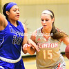 ROB FOUNTAIN/ STAFF PHOTO<br /> Clinton's Madison Rondeau (15) tries to drive by Fulton Montgomery's Karizma Fleurimond (20) Sunday during women's basketball in Plattsburgh.