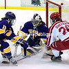 ROB FOUNTAIN/ STAFF PHOTO<br /> Plattsburgh's Melissa Sheeran (26) storms the net with Elmira's goalie Kyle Nelson (1) and Kiana Melvin (15) defending Sunday at the Ronald B. Stafford Ice Arena in Plattsburgh.
