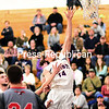 ROB FOUNTAIN/ STAFF PHOTO<br /> AuSable Valley's Kobe Parrow (14) goes in for a layup against Beekmantown Tuesday during Champlain Valley Athletic Conference boys basketball in Clintonville.