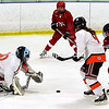 ROB FOUNTAIN/ STAFF PHOTO<br /> Plattsburgh High goaltender Corrinne Smith (30) dives for the puck, with teammate Micalli Johnston (9) holding off Saranac Lake's Sydney Andronica (18), during a Section VII girls hockey semifinal in Plattsburgh.