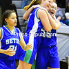 ROB FOUNTAIN/ STAFF PHOTO<br /> Seton Catholic players (from left) Nicole Bullock (21), Gretchen Zalis (33) and Cailene Allen (15) celebrate after defeating AuSable Valley in a Section VII Class C girls basketball semifinal Monday in Beekmantown.