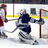 ROB FOUNTAIN/ STAFF PHOTO<br /> Plattsburgh's Meghan Kraus (13) puts the puck into the net past Middlebury goalie Julia Neuburger Wednesday during women's hockey at the Plattsburgh State Field House.
