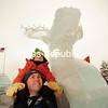 JACK LADUKE/ P-R PHOTO<br /> Wyatt Pytlak, 6, of Plattsburgh, rest on the shoulders of his father, Steve, as they look up at a 9-foot-tall moose carved from ice on the grounds of the Ice Palace in Saranac Lake.
