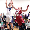 GABE DICKENS/ P-R PHOTO<br /> Peru's Jacob Casey goes in for the layup as Saranac's Cameron Duffield attempts a block during Thursday's Champlain Valley Athletic Conference boys basketball game at Peru Central School.<br /> 0-0-0, Munson 5-0-11. Totals: 15-5-39.