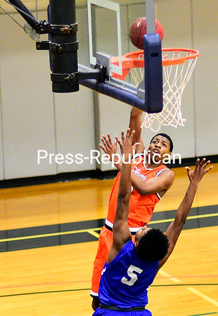 ROB FOUNTAIN/ STAFF PHOTO <br /> Clinton's Mathew Smiley (3) shoots over the top of Fulton Montgomery's Brandon Cooper (5) Sunday during men's basketball in Plattsburgh.
