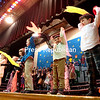 """GABE DICKENS/ P-R PHOTO<br /> Erin Moriarity's kindergarten class performs a scarf dance to the song """"Carmina Burana"""" by Carl Orf during the recent Music in Our School concert at Bailey Avenue School in Plattsburgh. The event also featured performances by the first- and second-grade classrooms, designed to demonstrate skills and concepts the children have been working on throughout the year as a part of the New York State Learning Standards, which calls for grade school children to be involved with music and the arts at a young age."""