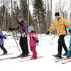 Gabriels residents Eric and Laura Holmes give a helping hand, and pole, to their daughters Karissa, 6, and Lena, 5, while Kaylee, 6, leads the pack during a cross-country ski outing at Dewey Mountain Recreation Center in Saranac Lake.<br /> GABE DICKENS/PR PHOTO  1-4-2017