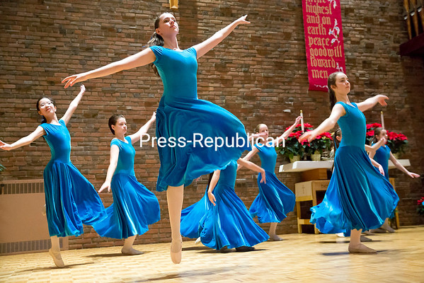 """GABE DICKENS/P-R PHOTO 1-9-2017<br /> Members of the Adirondack Liturgical Dance Troupe perform a routine to the song """"Noel"""" by Sarah McLachlan during the annual Twelfth Night Celebration, which also featured performances by the Essex Children's Choir of Vermont and harpist Heidi Soons, at the United Methodist Church in Plattsburgh Friday evening. Twelfth night marks the eve of Epiphany, when in the Christian faith, the Three Wise Men, or Magi, visit the infant Jesus with gifts of gold, incense, and myrrh."""