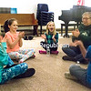 JESSICA BLONDELL/P-R PHOTO 1-30-2017<br /> Kristine Lutters, director of religious studies at Plattsburgh Unitarian Universalist Fellowship, gathers local children into a circle to start a game during the Kids Night Out event held Friday. Shown (left to right): Ella Hathaway, 9; Karina Paxton- Filoteo, 10; Elise Hathaway, 6; Kristine Lutters; and Kellen Young, 6.