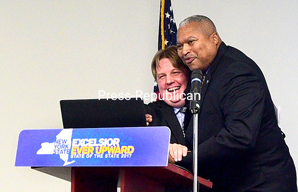 ROB FOUNTAIN/STAFF PHOTO 1-20-2017<br /> Town of Plattsburgh Supervisor Michael Cashman gets a big hug Wednesday from Samuel Roberts, commissioner of the State Office of Temporary and Disability Assistance, during a presentation of Gov. Andrew Cuomo's 2017 budget proposal at the Plattsburgh Town Hall on Banker Road.