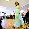 A model hits the runway, giving a look at the latest fashion in maid of honor dresses Sunday during the Laura's Bridal Annual Plattsburgh Bridal & Fashion Expo at the West Side Ballroom.<br /> ROB FOUNTAIN/STAFF PHOTO 1-11-2017