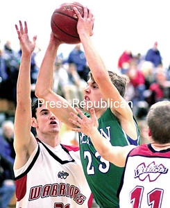 Alvin Reiner/P-R Photo 1-8-2017 Seton Catholic's Kevin Murray (23) makes his way toward the basket against two Willsboro defenders Friday in Mountain and Valley Athletic Conference boys basketball Friday.
