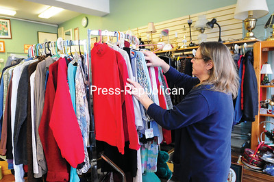ROB FOUNTAIN/STAFF PHOTO 1-2-2017 Karen Salka hangs clothes on a rack Wednesday at the Cats' Meow Thrift Shoppe in Plattsburgh. Store proceeds support the new Animal Rescue and Welfare Services, a nonprofit that is dedicated to finding homes for felines or having them spayed or neutered then released.