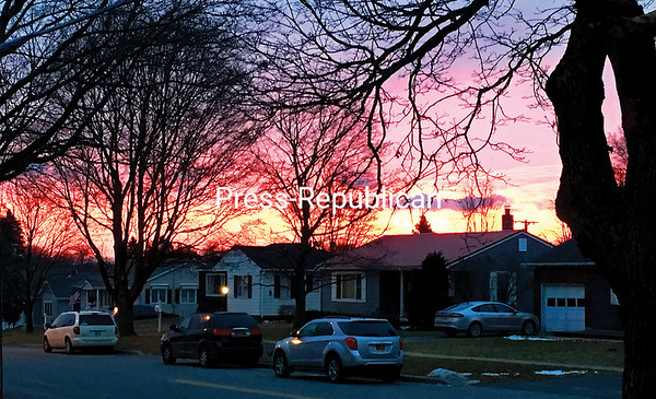 ROB FOUNTAIN/STAFF PHOTO 1-18-2017 The rising sun peeks over the tops of houses on Bailey Avenue in Plattsburgh on a recent morning. With the forecast calling for mostly clear skies the next few days, watch for colorful skies at sunrise and sunset.
